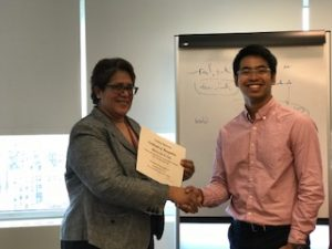 Anfemy Vanta receives a certificate of appreciation from Ally Spencer