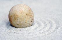 decorative image, stone resting on sand